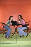 Two Young Women Having Coffee stock photos