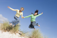 Two young women having fun at beach Stock Photography