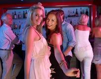 Two Young Women Having Fun In Busy Bar. Two Young Women Having Fun Dancing In Busy Bar stock photos