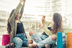 Two young women having fun in the city center Stock Images