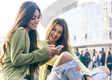 Two young women having fun in the city center Stock Photos