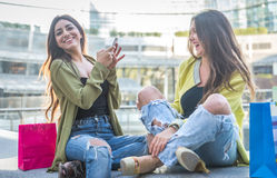 Two young women having fun in the city center Stock Photo