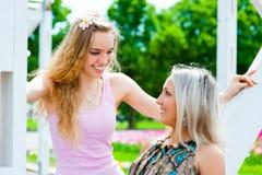 Two young women having fun Stock Photos
