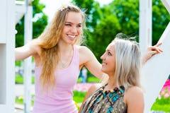 Two young women having fun Stock Photo