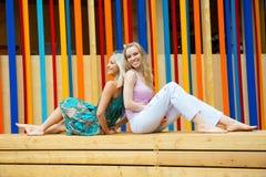Two young women having fun Royalty Free Stock Photos