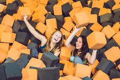 Two young women having fun with soft blocks at indoor children p Stock Photos