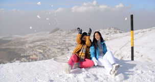 Two young women having fun in winter snow Stock Images