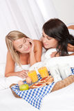 Two young women having home made breakfast Royalty Free Stock Images