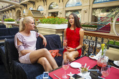 Two young women having lunch break together Royalty Free Stock Images