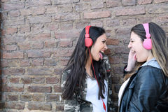Two young women with headphones. Stock Photo