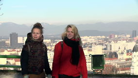 Two young women hike around stock footage