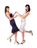 Two young women holding hands Stock Photo