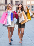 Two young women holding shopping bags Stock Images