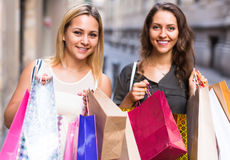 Two young women holding shopping bags Royalty Free Stock Photo