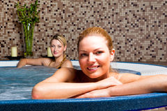 Two Young Women in Hot Tub Royalty Free Stock Photos