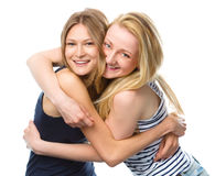 Two young women are hugging as a best friends Stock Photos