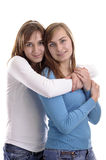 Two young women hugging each other Royalty Free Stock Images