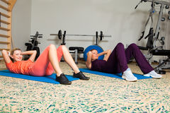 Two Young Women In Gym Stock Image