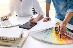 Two young women interior design or graphic designer working on p stock photography