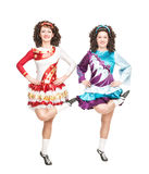 Two young women in irish dance dress dancing isolated Stock Photo