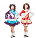 Two young women in Irish dance dresses posing isolated Royalty Free Stock Photography