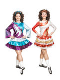 Two young women in Irish dance dresses posing isolated Stock Photo