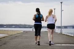 Two young women jogging royalty free stock photos