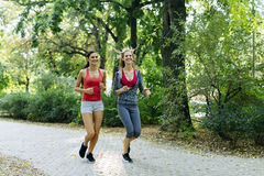 Two young women jogging Royalty Free Stock Photography