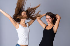 Two young women jumping Stock Photos