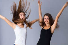 Two young women jumping Stock Images
