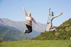 Two young women jumping Royalty Free Stock Images