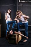 Two young women killed man stock photos