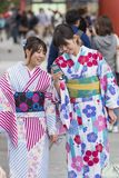 Two young women in kimono looking at mobile phone at Sensoji Bud Royalty Free Stock Image