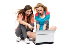 Two young women with laptop Stock Photos