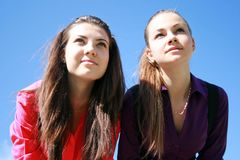 Two young women looking ahead Stock Image