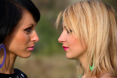 Two young women looking into each othe Royalty Free Stock Photo
