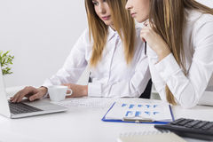 Two young women looking at laptop Stock Photo