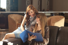 Two young women looking at the menue Stock Images