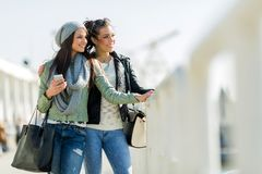 Two young women looking over a dock fence Royalty Free Stock Photos