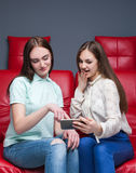 Two young women looking at pictures on phone Royalty Free Stock Photo
