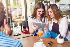 Two young women looking at a tablet Stock Photo