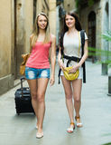 Two young women with luggage Royalty Free Stock Photography