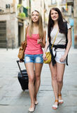 Two young women with luggage Stock Photography