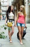 Two young women with luggage Stock Image
