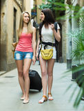 Two young women with luggage Stock Photos