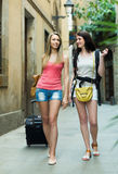 Two young women with luggage Royalty Free Stock Images