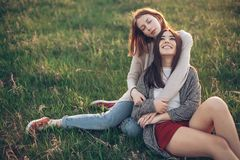 Two young women lying on the grass Stock Image