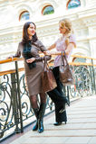 Two young women in a mall Stock Photo