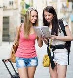 Two young women with map Royalty Free Stock Photo