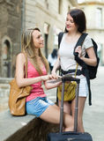 Two young women with map Royalty Free Stock Image